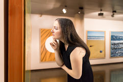 Looking at a work of art onn the museum Stock Photo