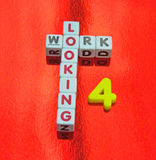 Looking for work. Text 'looking for a job' with uppercase letters inscribed on small white cubes and the number 4 replacing for, red background royalty free stock photography