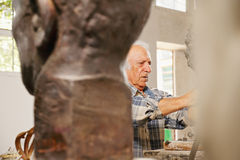 Looking at the working sculptor Royalty Free Stock Images