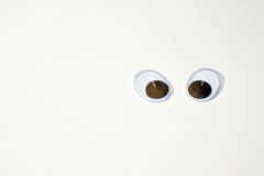 Looking into the world with big eyes. Two movable plastic eyes on a white background with copy space for text Stock Photo