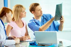 Looking at x-ray results Stock Photography