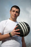 Looking at you. An image of a young man holding the ball Royalty Free Stock Images