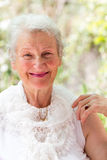 Looking at You Positively. Grandmother still looking at you positively with her white hair and complimenting nice clothing Royalty Free Stock Photography