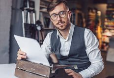 Looking young writer at work. In the office royalty free stock photo