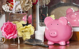 Looking after your money. Piggy bank on a dressing table Royalty Free Stock Photo