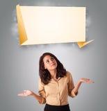 有吸引力的妇女lookint现代origami拷贝空间 免版税库存图片