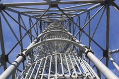 Lookout. Iron construction tower in blue sky Stock Image