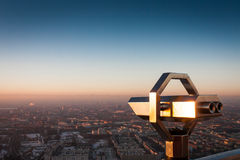 Lookout binoculars over city Royalty Free Stock Photo
