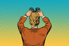 Lookout businessman with binoculars. Pop art retro vector illustration drawing Royalty Free Stock Photography