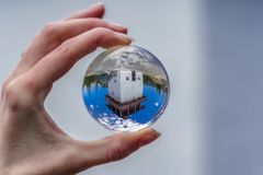 Lookout called Veza in village Velke Borove, Slovakia. Lensball in hand royalty free stock image