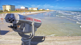 Lookout from the Cocoa Beach Pier. Old worn out sign on a set of binoculars to view Cocoa Beach Florida from it's pier Royalty Free Stock Photography