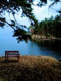 A lookout onto a peaceful still channel in the gulf islands from stock images