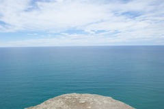 Lookout over ocean from edge of rock platform Royalty Free Stock Image
