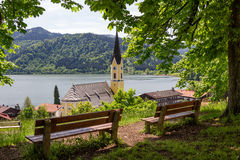 Lookout point above schliersee village with wooden benches Stock Photo