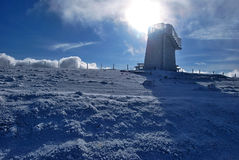 Lookout on Pretulalpe hill in winter Fischbacher Alpen mountains in Styria with sun Stock Photo