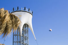 Lookout tower and para glider. Over blue sky Royalty Free Stock Photos