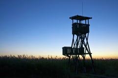 Lookout tower at sunset Stock Photos