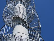 Rotating metal stairs - geometric patterns. stock images