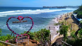 Looks great on the beach. Looks the scenery on the rocky beach at noon time, located in jogjakarta Indonesia Stock Image