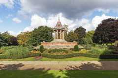 Dark clouds gather over Nottingham Arboretums  Chinese Bell Tower Stock Image