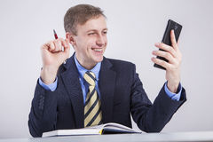 Looks smartphone smiling Royalty Free Stock Image