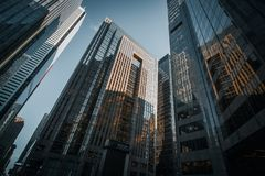 Lookup wide-angle view on glass skyscrapers stock photography