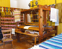 Loom. Old fashioned loom in weaving shop in pioneer setting Royalty Free Stock Photo