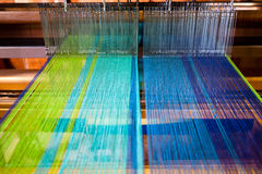 Multicolored threads on a loom. Multicolored threads on a manufacturing loom Stock Images