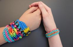 Loom band bracelet on a young girls' forearms Stock Image