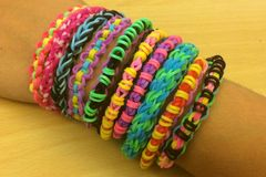 Loom band bracelets on girls arm Royalty Free Stock Photo