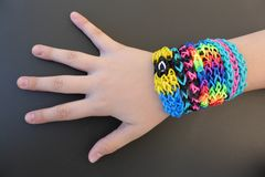 Loom band bracelets on a young girl's arm Stock Photos