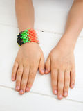 Loom band braclet on childs wrist Stock Images