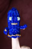 Loom band ghost. A child's hand decorated with an original blue ghost doll made using loom rubber bands Royalty Free Stock Photo