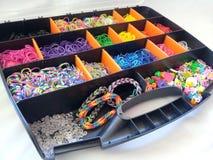 Loom band storage box and bracelets Royalty Free Stock Photography