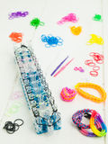 Loom banding tools, band loom and multicoloured elastic bands Stock Image