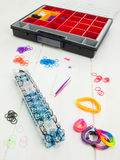 Loom banding tools, hobby box and multicoloured elastic bands Royalty Free Stock Photography