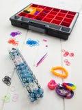 Loom banding tools, hobby box and multicoloured elastic bands Royalty Free Stock Image