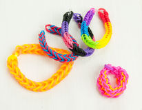 Loom bracelets on a white table top Stock Photo