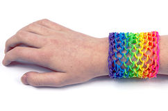 Loom bracelets on a young girl's hand Royalty Free Stock Image