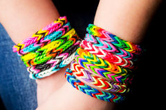 Loom bracelets. On a young girl's hands.Wearing jeans. Young fashion concept Stock Images