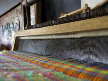 Loom with colorful threads. Weaving with a loom, bright cloth stock images