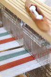 Loom. Foot-treadle floor loom with threads Royalty Free Stock Images