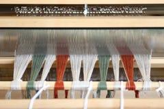 Loom. Foot-treadle floor loom with threads Royalty Free Stock Image