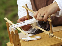 Loom and hands Royalty Free Stock Photo