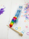 Loom and multicoloured bracelet Stock Image