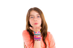Loom rubber bands bracelets blond kid girl blowing. Hand on white background Royalty Free Stock Image