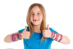 Loom rubber bands bracelets blond kid girl Stock Images