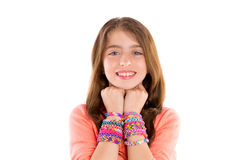 Loom rubber bands bracelets blond kid girl smile. Loom rubber bands bracelets blond kid girl smiling hands in neck on white background Royalty Free Stock Photo