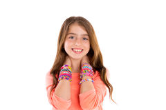 Loom rubber bands bracelets blond kid girl smile. Loom rubber bands bracelets blond kid girl smiling hands in neck on white background Royalty Free Stock Image