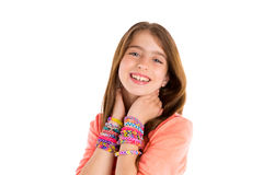 Loom rubber bands bracelets blond kid girl smile. Loom rubber bands bracelets blond kid girl smiling hands in neck on white background Stock Image